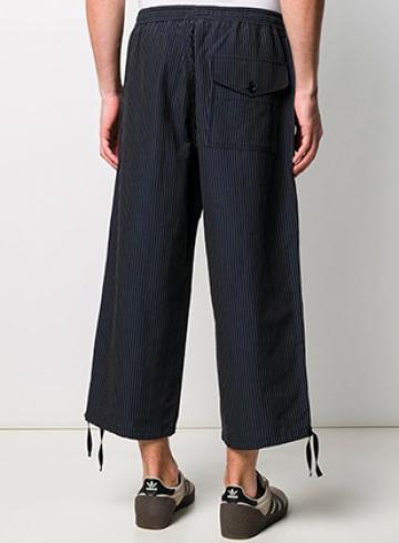 Купить брюки на Farfetch